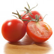Red tomatoes isolated on white background — Stock Photo