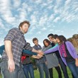 Multiracial Students with Hands on Stack — Stock Photo #10789152