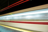 Motion blur outdoor of high speed train in subway — Stock Photo