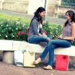 Stock Photo: Two girls with colored bags outdoor