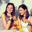 Two Young Women Cheering with Cold Drinks — Stock Photo #10980302