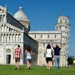 Four Friends on Vacation Visiting Pisa — Stock Photo #11069235