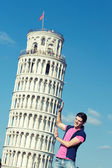 Young Man with Leaning Tower of Pisa — Stock Photo