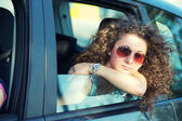 Pensive Girl Looking out of Car Window — Stock Photo