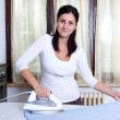 Stock Photo: Bright picture of lovely housewife with iron