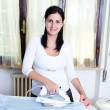 Royalty-Free Stock Photo: Bright picture of lovely housewife with iron