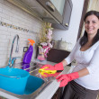 Bright picture of lovely housewife with iron — Stock Photo