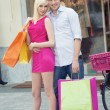 Young attractive couple in shop — Stock Photo