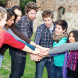 Multiracial Students with Hands on Stack — Stock Photo