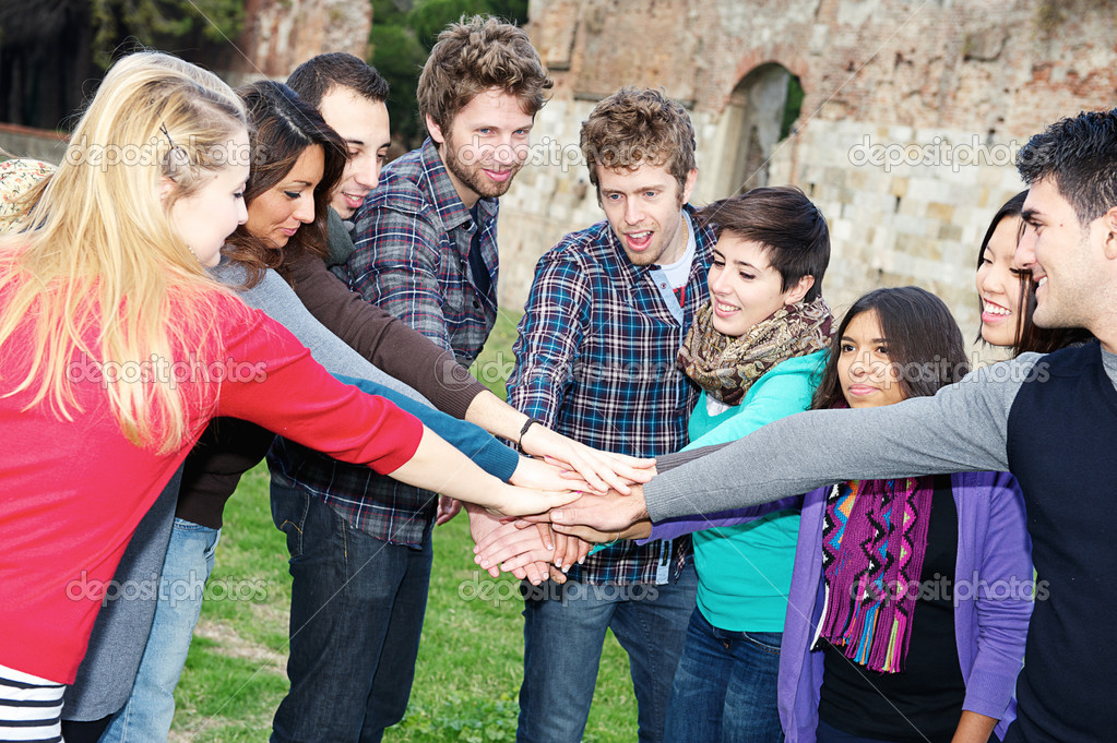 Multiracial Students with Hands on Stack, Italy — Stock Photo #11893675