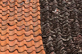 Red and old roof tiles — Stockfoto