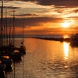 Stock Photo: Sailboats silhouette in harbor with sunset