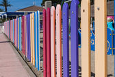 Colourful rows of painted wood on a playground fence — Stock Photo