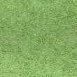 Green plastic grass field top view texture — Stock Photo