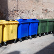 Plastic big trash recycling bins on the street - Stock Photo