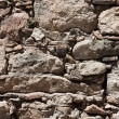 Damaged gray stone wall texture background — Stockfoto #11449488