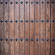Cool wood door with nails — Stock Photo #11495432