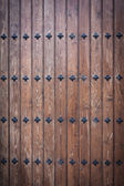 Cool wood door with nails — Stock Photo