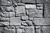 Cool vintage black and white stone wall texture background — Stock Photo