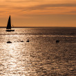 Sailing boat silhouette at sunset — Stock Photo