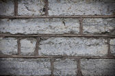 Damaged gray stone wall texture background — Stock Photo