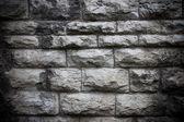 Damaged vintage stone wall texture — Stock Photo