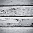 Weathered black and white wood wall background — Stock Photo