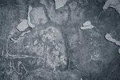 Ciemnoszary krawędziach tynk tło — Zdjęcie stockowe