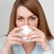 Girl with a cup of coffee drinkers — Stock Photo #10934076
