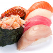 Assorted Sushi small. On a white background. Salmon, tuna, yello - Foto Stock