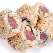 Uramaki with tuna. On a white background. Tuna, rice, sesame see - Foto Stock