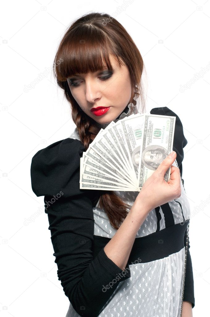 Young girl shows a fan of money. On a white background. — Stock Photo #11664926