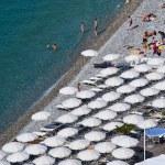 Sunbathers on Rocky Beach of Nice — Stock Photo #10984338