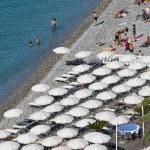 Sunbathers on Rocky Beach of Nice — Stock Photo #10984346