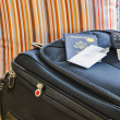 Roll Aboard Bag on a Hotel Bed — Foto de Stock