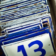 Stock Photo: Enamel number plates with number thirteen in front