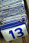 Enamel number plates with the number thirteen in front — Stock Photo