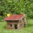 Wooden house on the grass. — Stock Photo #10929096