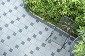 Patio blocks with chair — Stock Photo