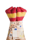 Hands painted flag Spain cuffed 50 euro bills — Stock Photo