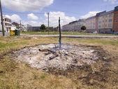 Ashes of a bonfire in an urban environment — Stock Photo
