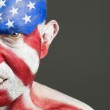 Man with his face painted with the flag of USA, aggressive expre — Stock Photo #11590425