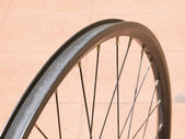Metal rim bicycle wheel — Stock Photo