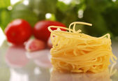 Italian pasta with tomato, garlic and basil — Stock Photo