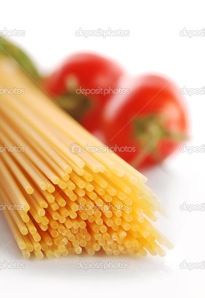 Spaghetti with tomatoes on the white background — Stock Photo #11093330