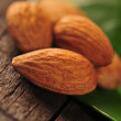 Almonds on the wooden table - Stock Photo