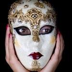 Portrait of a woman wearing a venetian mask — Stock Photo #11103644