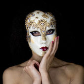 Portrait of a masked woman. — Stock Photo