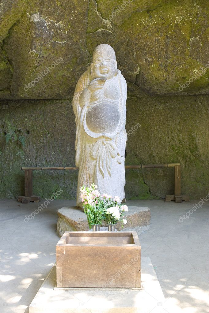 Statue of Hotei (God of Contentment and Happiness) at Jochi-ji temple, Kamakura, Japan — Stock Photo #10865419