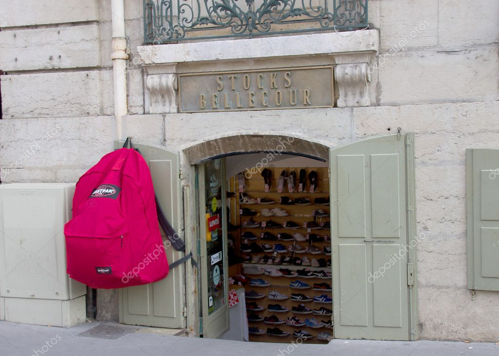 Huge backpack at the entrance of sport store. Lyon, France. — Stock Photo #11717377
